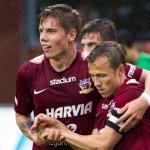 Veikkausliiga Asian handicap: JJk's midfielder Tommi Kari is being held by co team mates after a good attack